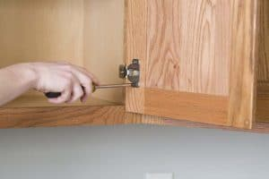 removing cabinet hinges