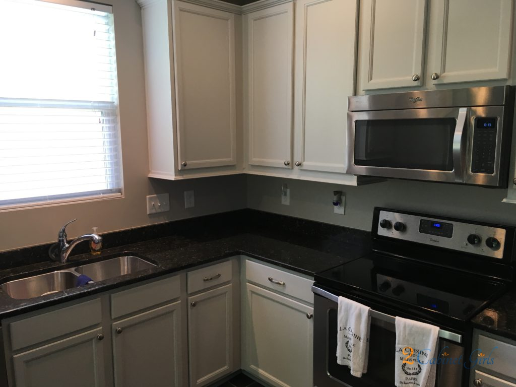 Balboa Mist Came To The Rescue Again In This Kitchen Our Homeowner Wanted A Soft Warm Color On Wall Cabinets And Rich Dark Gray Island