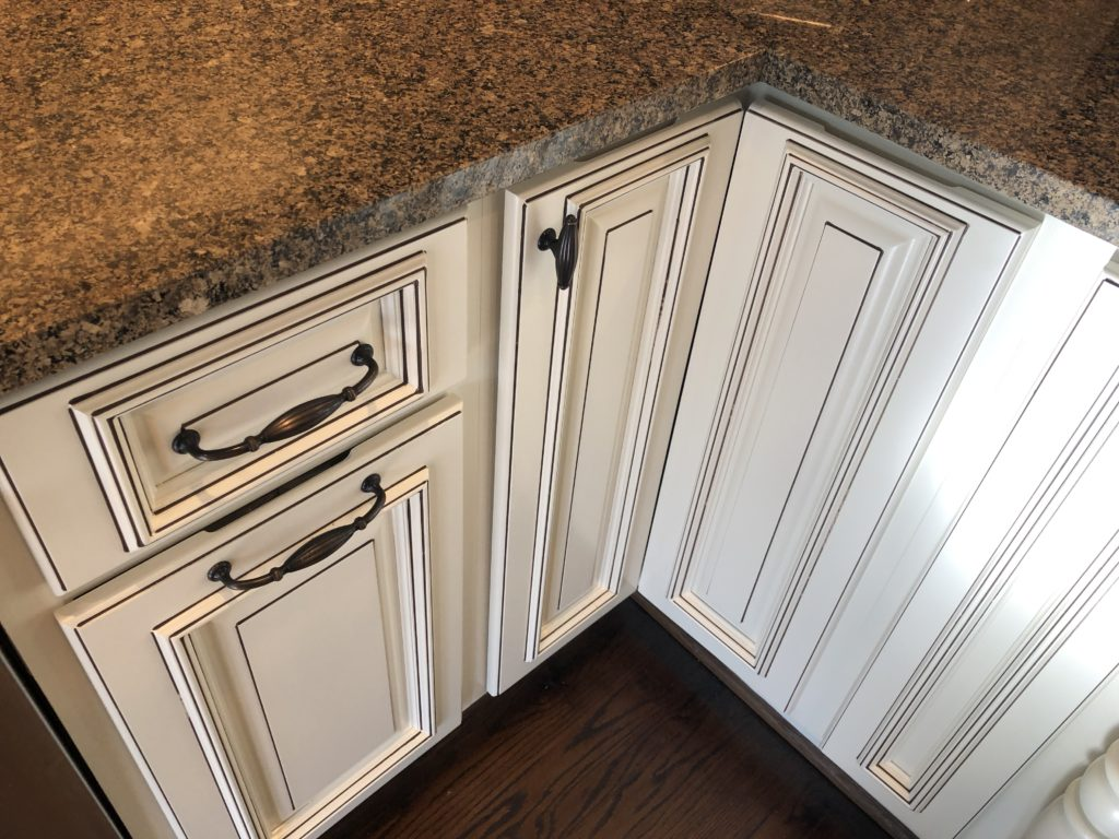 Painted kitchen cabinets with pinstriped glaze added
